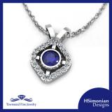 14K WHITE GOLD PENDANT, .58 CTW DIAMONDS WITH .75CT BLUE SAPPHIRE